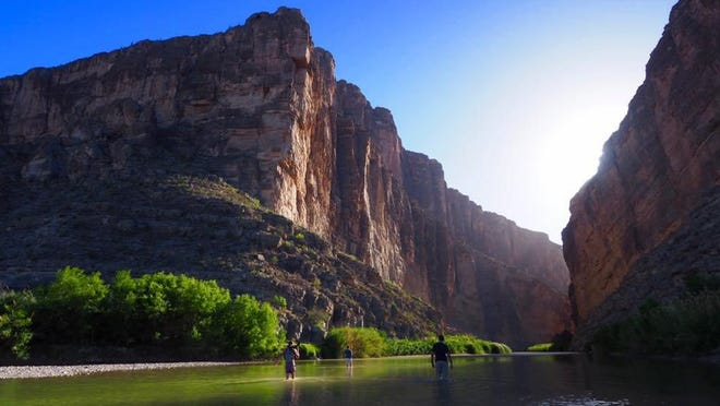 Visitors to Big Bend National Park wade into the Rio Grande at Santa Elena Canyon in January 2017. Big Bend reopened for day access June 1.