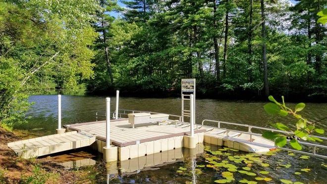 The Rochester Riverwalk's new accessible canoe and kayak launch was installed along the Cocheco River near Hanson Pines on Wednesday, much to the delight of members of the city's Riverwalk Committee.