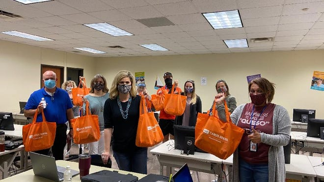 New Smithville school district employees receive welcome bags prepared by the Smithville Chamber of Commerce which feature goodies from area businesses.
