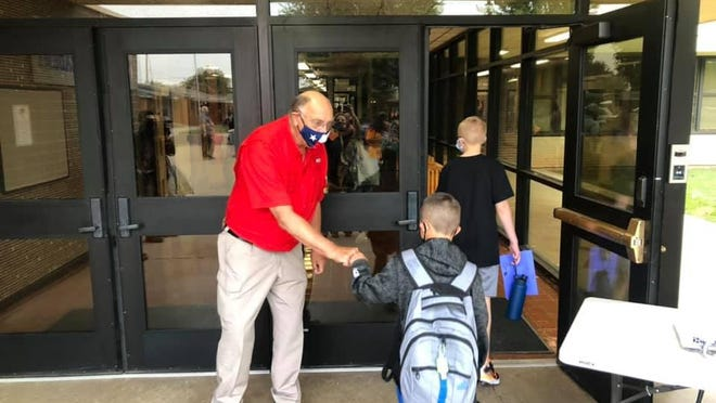 William C. McCool's parents were at the opening of the school, greeting students as they started the first day of school Monday.