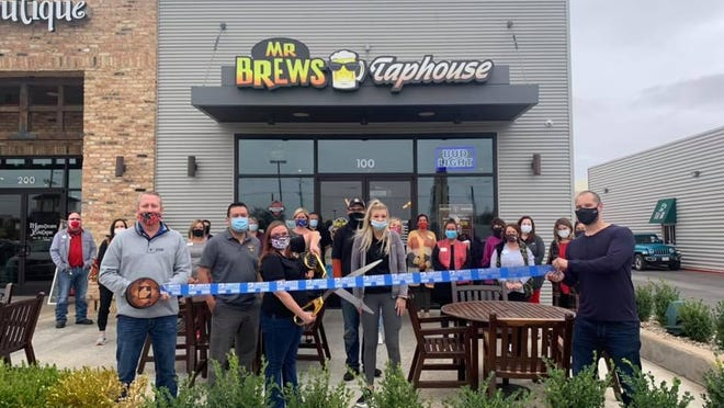 Ribbon cutting - Mr Brews Taphouse, 7604 Milwaukee Ave., Ste. 100. Holding scissors: General Manager Christy Searcy. Holding ribbon Chamber Ambassadors Rhett Dawson, left, and James Ruiz. Also pictured: owner Jonathan Langford, and other staff, friends, family and Chamber Ambassadors.