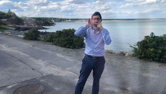 Rabbi Berel Slavaticki of Seacoast Chabad Jewish Center blows the shofar at Ogunquit Beach.