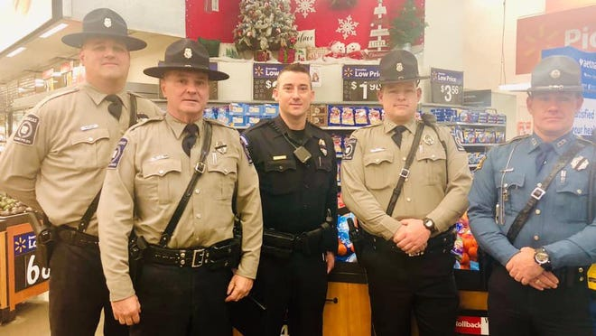 Alma police officers are seen during the 2019 Shop with a Cop event. A recent donation by the Arvest Foundation will be used by the Alma Police Focus Group's annual event.