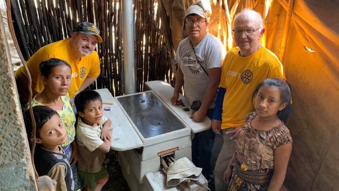 Justin Provencher, top left, VP/Credit Manager at Avidia Bank, spent a week in Guatemala volunteering to install ONIL stoves for families with Rotary Club International.