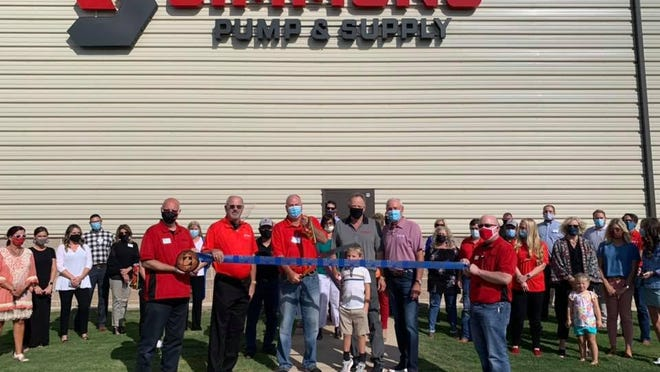 Simmons Pump & Supply, 2805 Interstate 27, marks its one-year anniversary. Holding scissors is president Joe Ryker. Holding ribbon  are Chamber Ambassadors Nickoy Kunkel, left, and Tobe Callahan.Others pictured are LEDA staff; Joe, Don, Fallon and David Pickering; and other staff, family, friends and Chamber Ambassadors.