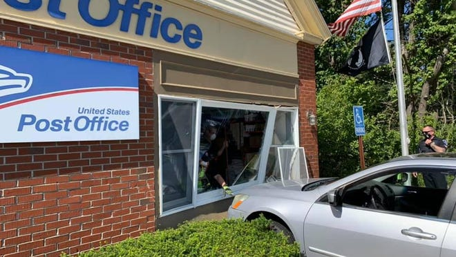 The North Hampton Post Office closed Monday after a driver crashed into the building on Route 1.