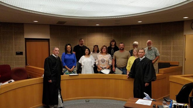 Casa of Grayson County swore in new volunteers recently. Pictured are, on the bottom row, Judge Brian Gary, Tequila Ezell, Gloria Darnell, Samantha Neill, Larry Mayes, Sunny Mayes, and Judge Jim Fallon. Pictured on the top row are Eric Eggen, Jessica Eggen, ZaVonna Arrington, Angie Williams, and Marvin Williams.