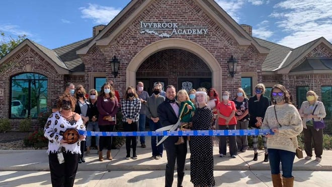 Ribbon cutting - Ivybrook Academy, 8717 Milwaukee Ave. Holding scissors: owners  Ryan, Rachel and Emmy Burden. Holding ribbon - Chamber Ambassadors Tracy Polk, left, and Sami Mullins. Also pictured: Bram Burden, and other staff, family, friends and Chamber Ambassadors.