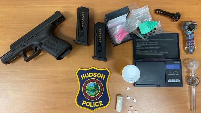 Hudson Police recovered this gun and drugs after a shoplifitng arrest last week.