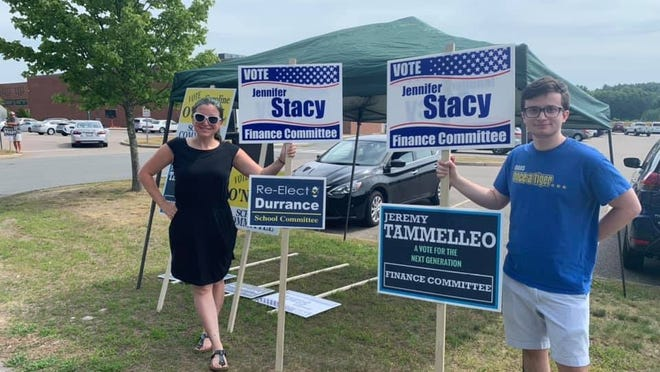 Finance Committee members Jennifer Stacy, left, and Jeremy Thomas Tammelleo stand outside Oliver Ames High School during the town's annual election held Saturday, July 27. Both won election to the FinCom.