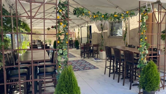 Toscana Bar Italiano has an outdoor patio that's ready for patrons.