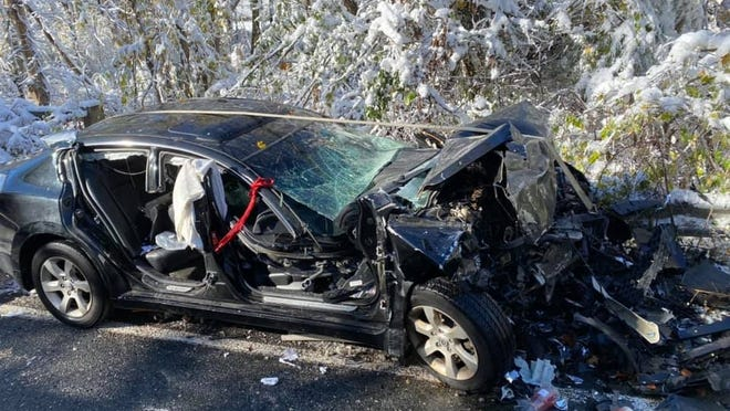 One of the cars invovled in a serious crash on Saturday in Millis where three people were injured.