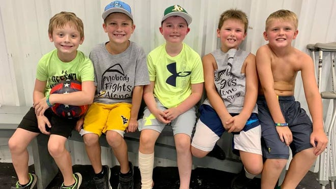 Friends Mason Whitacre, Beckham Dolly, Greysen McCullough, Ashton Laffey and Cage Blackburn pose together with smiles at the Greysen Strong Field Day event.  Photo courtesy of Jackie Laffey