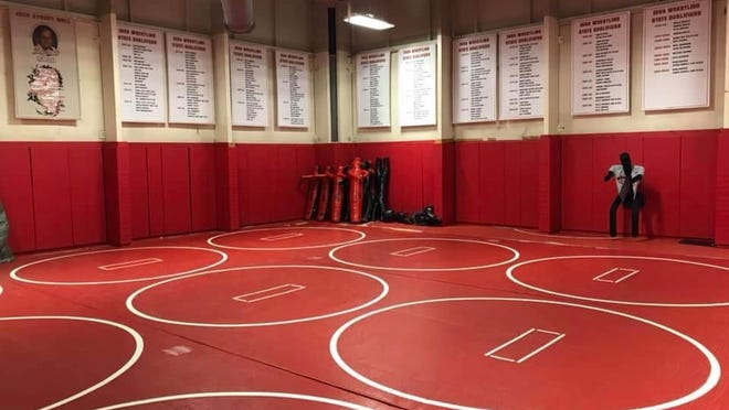The 10 banners that contain the names of Pekin wrestlers who have qualified for the state tournament are on the Jack Stoudt Wall in the Pekin wrestling room.