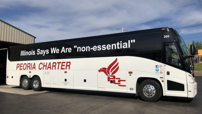 This May photo shows one image of a Peoria Charter Coach bus, spotlighting company owner Bill Winkler's concern about the state's COVID-19 restrictions.