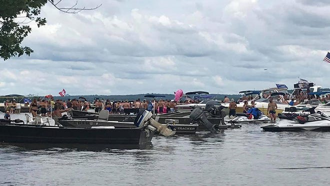 Boats and boaters crowd together Saturday during the annual White Trash Bash on the Illinois River.
