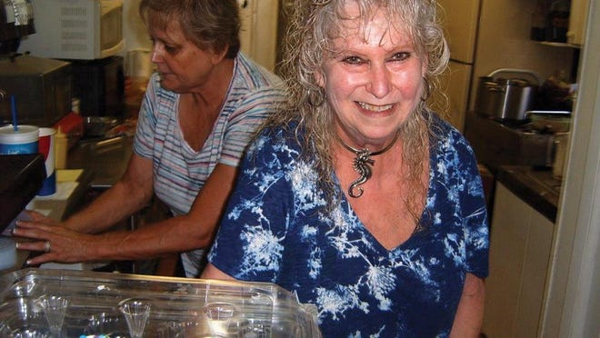 In this 2017 photo, Susie Perdue, right, pauses during the lunch rush at her Susie's Hot Dogs, 103 W. Bradley St. At left is her friend and longtime employee, Ruth Crist. For 33 years, she owned and ran the tiny eatery, until she died unexpectedly Aug. 31. Her survivors plan to keep the eatery going.