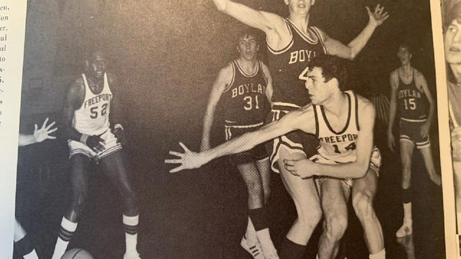 Tom Norman (14) throws a bounce pass while Ron London (52) sets up outside during a 1974 Freeport game against Boylan. Freeport finished 28-2 that year, were the first conference team to ever go 16-0 and won their last outright conference boys basketball title.