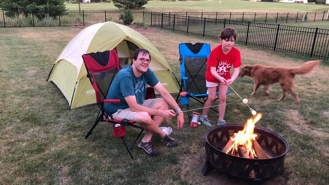 Although the COVID-19 pandemic has forced the cancellation of gatherings like summer day camps, Cub Scouts who participated in the W.D. Boyce Council's Adventure Camp at Home could still experience the thrill of building a campfire and the fun of toasting marshmallows over it.