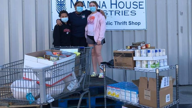The Long family donated more than 300 pounds of food to Manna House.