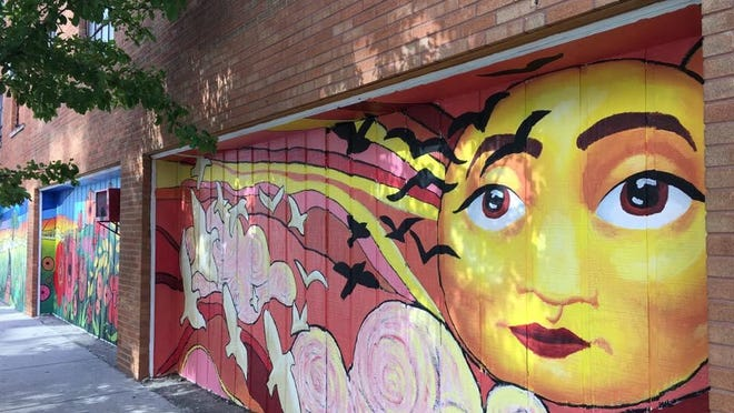 A mural painted by a group of teens in downtown Springfield based on a Vachel Lindsay poem.