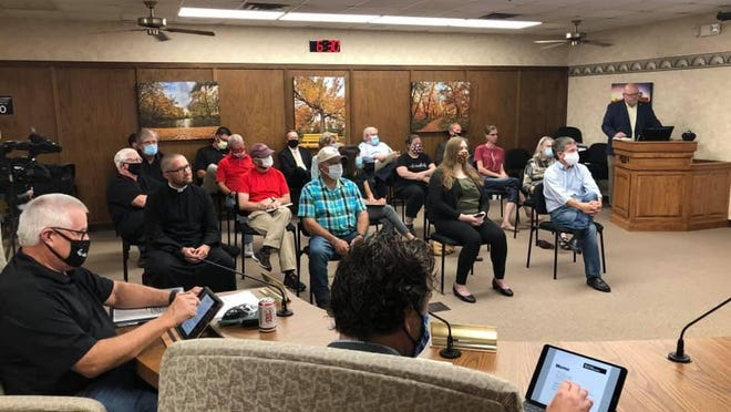 The room was packed for Thursday night's Hays City Commission meeting, with many in the hallway for social distancing, and taking the podium to speak.