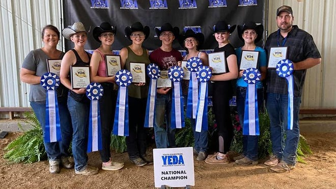 Nichole McColley (far left) and Travis McColley (far right) pose with members of their McColley Equestrian Team that won the 2020 YEDA Nationals senior high team competition in Cleveland, Tennessee. Photo by Nichole McColley; published with permission