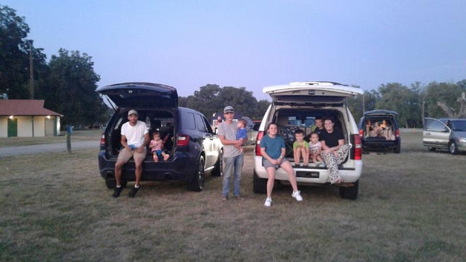 Smithville residents enjoy a drive-in movie and live music community event over the weekend at Riverbend Park. The Smithville Chamber of Commerce organized the event.