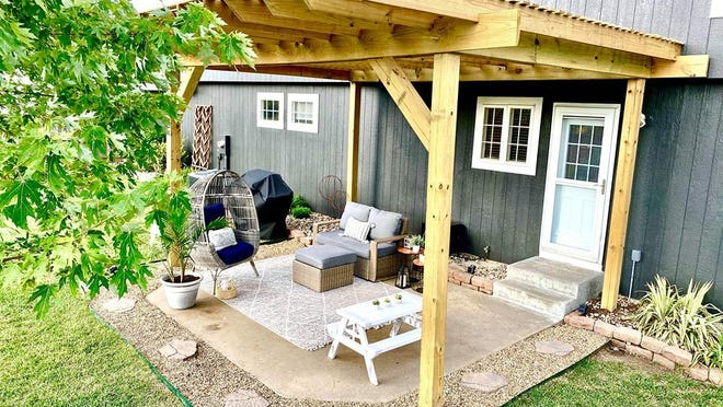 Keith Barkemeyer traded his vacation plans for a new pergola and custom fire pit in response to cancellations caused by COVID-19. Future planned additions include a fan, lights and outdoor speakers.