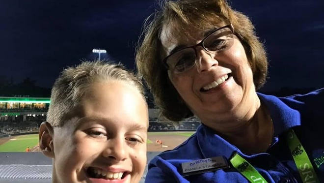 The RECing Crew founder Pam Stickler, right, hanging out with her grandson Anthony Smith, during a baseball game at SRP Park in North Augusta.