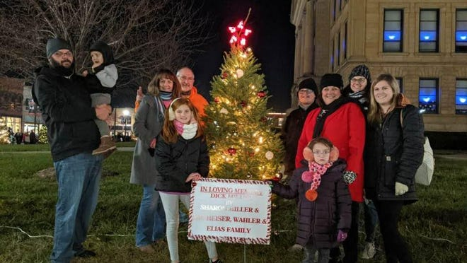 Family memories were made by paying tribute to the late Dick Miller. The family of Dick Miller sponsored a tree at this year's Winter Wonderland that runs until the end of the year. From left are: Jordan and Logan Bunner, Debbie and Rick Heiser in front of them Kate Ray, Kinley Ray, in the back Kobe Bunner, Rendi Ray, Kelly Miller Elias and Holly Palmer.
