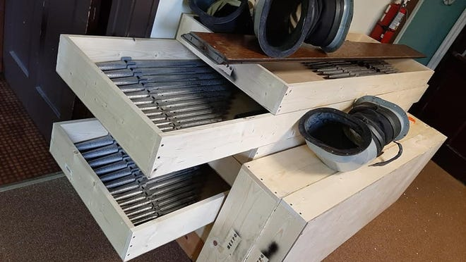 Pipes and connecting parts from St. Paul's organ are moved for updates and repair efforts.
