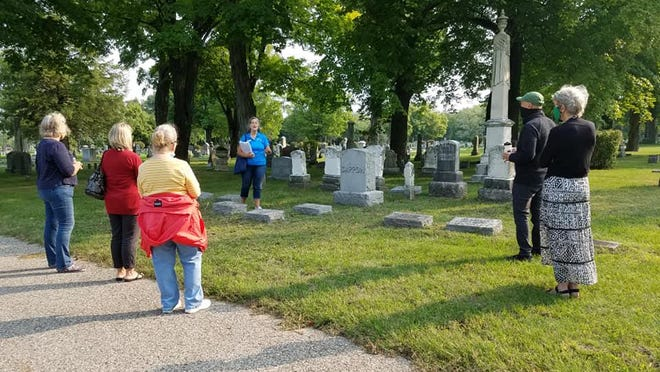 Linda Kaiser of Holland Tasting Tours shares the history of Pilgrim Home Cemetery with visitors as a COVID-friendly alternative to her usual downtown tasting tours.