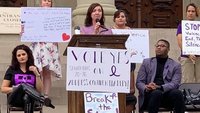 Melissa Beal of Adrian Township speaks during last year's domestic violence awareness rally at the state Capitol in Lansing. Beal is one of the organizers for the rally that returns for year two on Thursday.