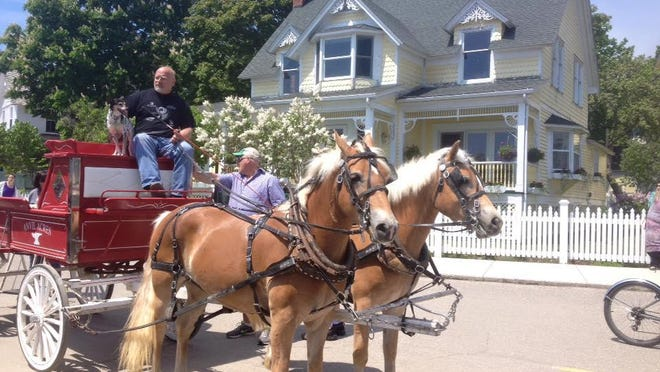 "Mackinac Island is often called Michigan's ""crown jewel,"" featuring horse-drawn carriages, an annual lilac festival and famous sweet treats like fudge."