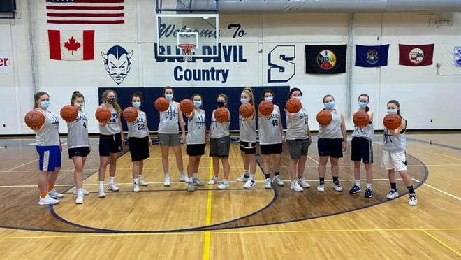 The Sault High girls basketball team is pictured in their home gym. The season can now officially start Monday. Sault High is scheduled to visit Rudyard for the opener for both teams.