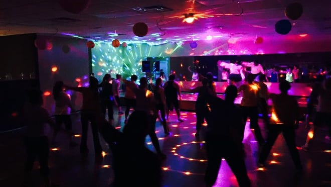 Glow-in-the-dark classes at Cosmic Studios allow participants to become less self-conscious so they can concentrate on exercise.