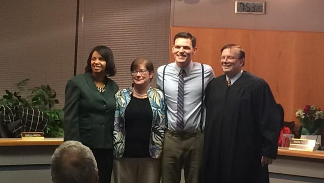 New Plymouth-Canton Board of Education members Kim Crouch (from left), Kate Borninski and Michael Siegrist were sworn in Wednesday by Wayne County Judge Mark Slavens, a former school board member. Crouch is on the current board; Borninski and Siegrist join her next month.