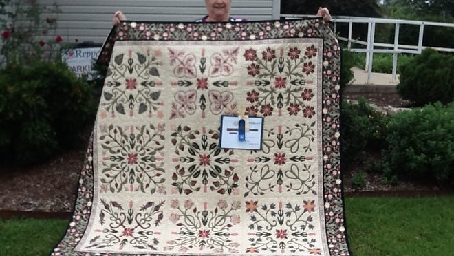 Maureen Forster of Mountain Home displays her quilt which won first at Baxter County Fair for best workmanship on a quilt. She is a member of Hill 'N Hollow Quilters Guild.