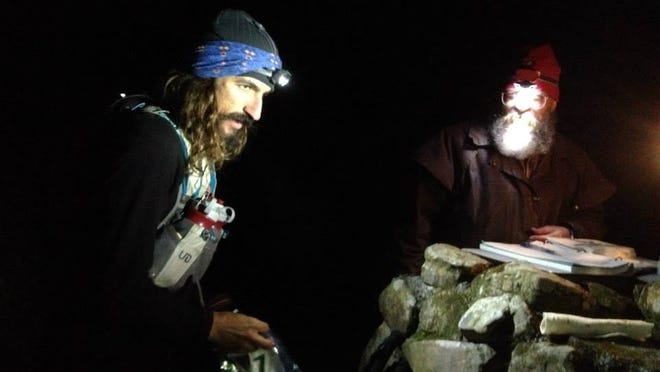 "Jamil Coury of Phoenix (left) says it can ""get weird out there"" running at night, which is one of the reasons he loves doing it. Coury checks in with Laz Cantrell (right), co-creator of the Barkley Marathons in Tennessee during this year's race."