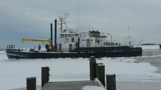 The J Millard Tawes, a Department of Natural Resources buoy tender, cuts through ice Feb. 18, Below-freezing temperatures froze the Tangier Sound and stopped island traffic to the mainland this week. The cutter enabled supply boats to get through earlier this week.