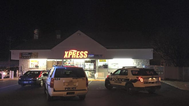 Police respond to an armed robbery Saturday night at Xpress Mart on East Oak Road.