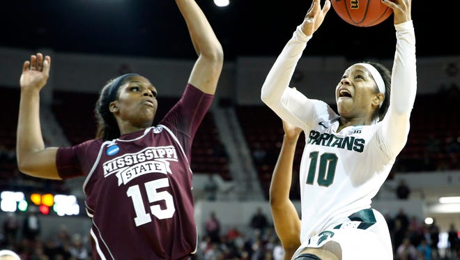 Michigan State guard Branndais Agee (10) attempts a shot at the basket while Mississippi State center Teaira McCowan (15) defends during the second half. Mississippi State won 74-72.