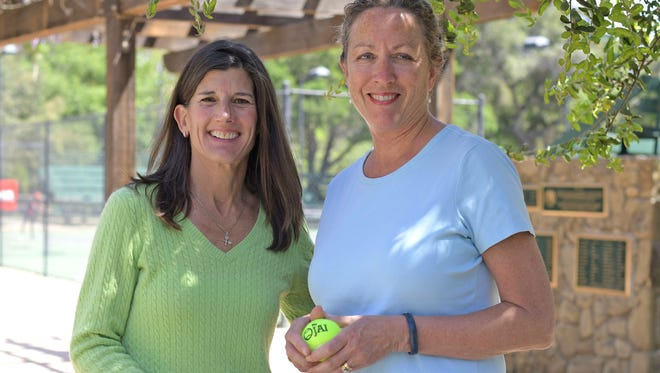 Longtime Ojai residents Katrina Rice Schmidt, left, and Carolyn Burke are two of the leaders of the prestigious Ojai Tennis Tournament, which is in its 118th year and has its first full day of competition Thursday. Schmidt is in her first year as the Tournament Executive Director and Burke is in her first year as president of the Ojai Valley Tennis Club.