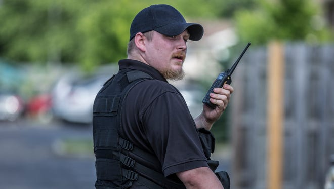 A private security guard who works for the apartment complex calls for backup as members of the media attempt to get closer to the crime scene.
