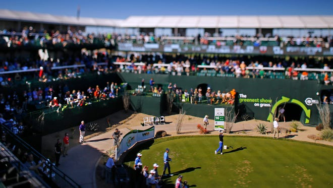Kevin Na hits from the 16th tee during the final round of the Waste Management Phoenix Open golf tournament at TPC Scottsdale in Scottsdale, Az., on Sunday, February 7, 2016.