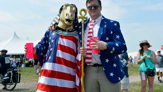 Logan Skillman and Mike Claimano pose for a picture before the 140th Preakness Stakes at Pimlico Race Course.