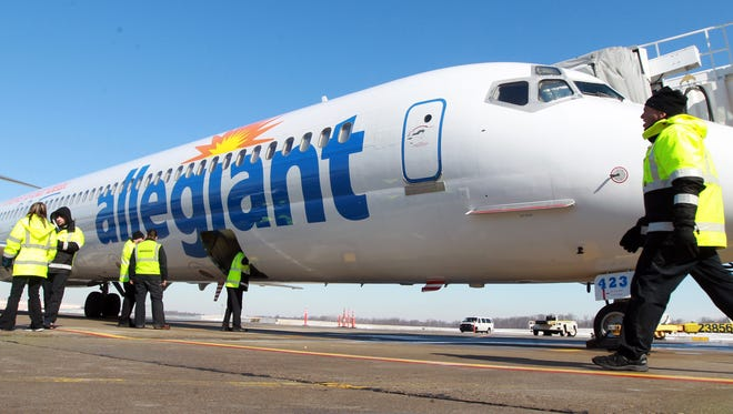 Ground crew members prepare the first Allegiant Air departure from Cincinnati/Northern Kentucky International Airport on February 12.