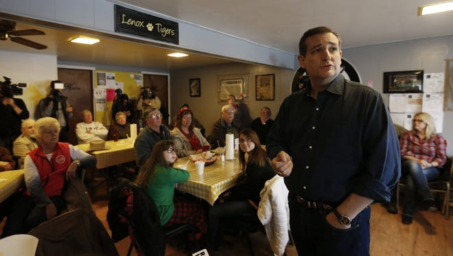 Republican presidential candidate Ted Cruz answers questions from community members Saturday, Nov. 28, 2015, during a campaign stop at the Tiger Den restaurant in Lenox, Iowa.