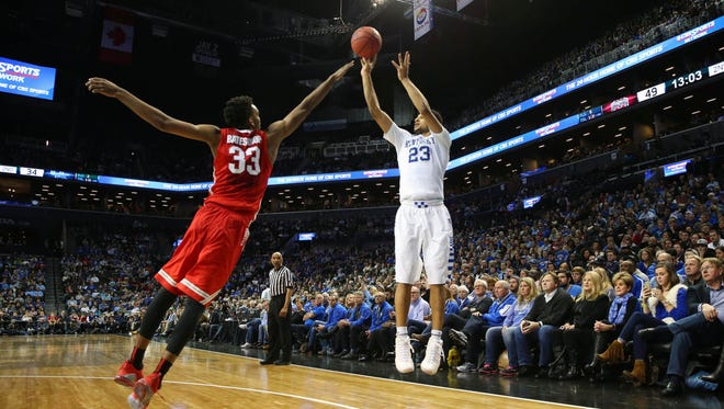 Dec 19, 2015; Brooklyn, NY, USA; Kentucky Wildcats guard Jamal Murray (23) shoots over Ohio State Buckeyes forward Keita Bates-Diop (33) during the second half at Barclays Center. Ohio State Buckeyes won 74-67. Mandatory Credit: Anthony Gruppuso-USA TODAY Sports